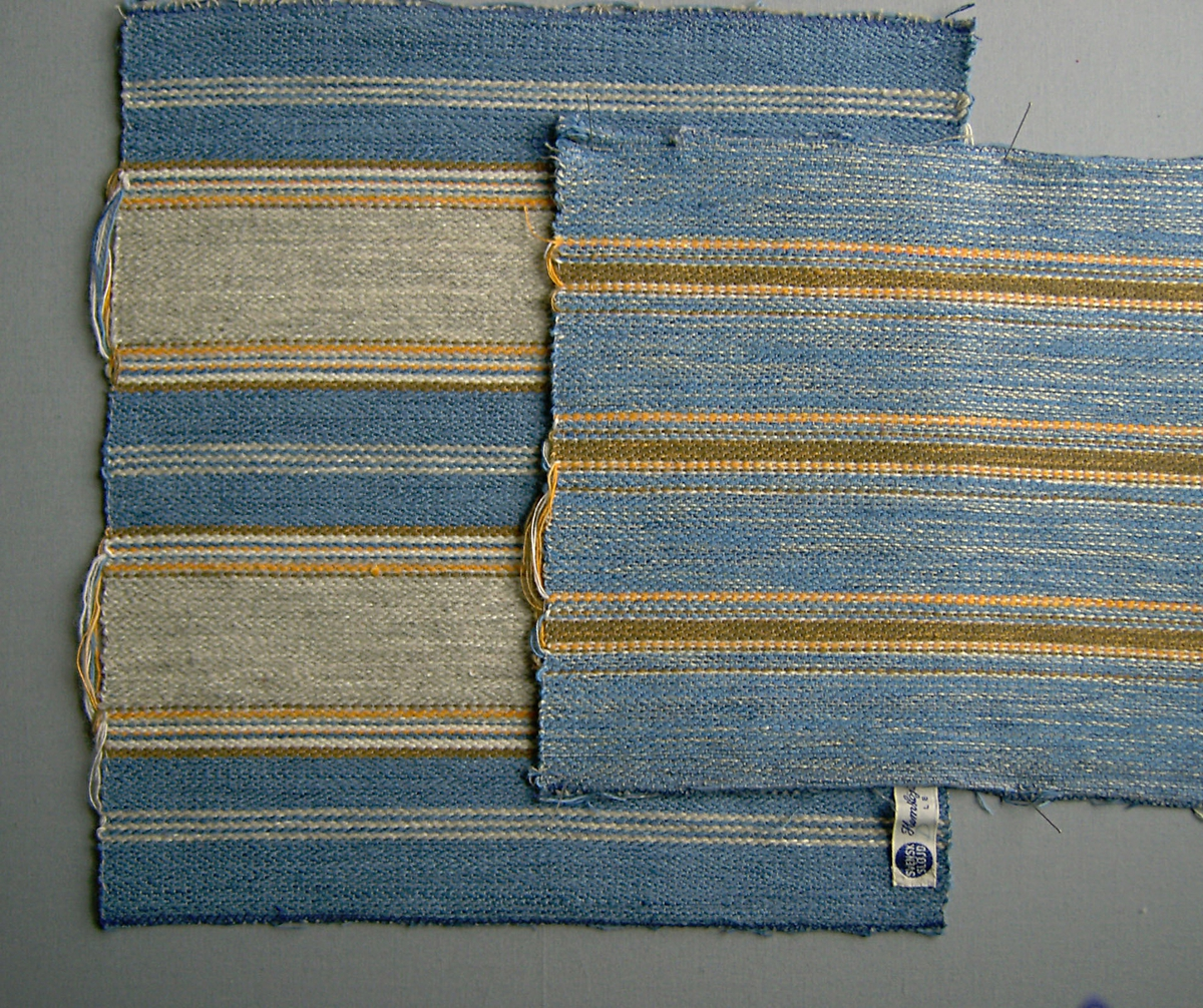 """Sjutton vävprover, möbeltyger i bomull, ull och lin vävda i korskypert med inslagseffekt. Flera olika prover på färger och randningar. Tyget är framtaget/vävt till kungaparet, någon uppgift om när finns ej. Varp i grått bomullsgarn nr 16/2. Inslag i ullgarn; 1-trådigt möbeltygsgarn och lingarn nr 16/1 och 16/2 i blått, grönt, brunt, grått, orange och rött. Flera trådar tillsammans. Tillhörande lapp med texten: """"Provvävar till Kungliga möbeltyget"""" de flesta vävproverna är märkta """"Hemslöjd - Föreningen LEKSAND"""".  WLHF-714:1 Längd 315 mm, bredd 290 mm. Blå. WLHF-714:2 Längd 230 mm, bredd 295 mm. Blå. WLHF-714:3 Längd 225 mm, bredd 295 mm. Blå. WLHF-714:4 Längd 295 mm, bredd 290 mm. Blå. WLHF-714:5 Längd 220 mm, bredd 295 mm. Blå. WLHF-714:6 Längd 225 mm, bredd 295 mm. Blå. WLHF-714:7 Längd 220 mm, bredd 295 mm. Blå. WLHF-714:8 Längd 220 mm, bredd 295 mm. Blå. WLHF-714:9 Längd 130 mm, bredd 265 mm. Blå. WLKHF-714:10 Längd 275 mm, bredd 225 mm. Blå. WLHF-714:11 Längd 75 mm, bredd 290 mm. Blå. WLHF-714:12 Längd 220 mm, bredd 255 mm. Grön. WLHF-714:13 Längd 225 mm, bredd 260 mm. Grön. WLHF-714:14 Längd 125 mm, bredd 240 mm. Grön. WLHF-714:15 Längd 285 mm, bredd 265 mm. WLHF-714:16 Längd 230 mm, bredd 265 mm. WLHF-714:17 Längd 190 mm, bredd 260 mm."""