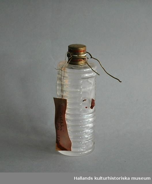Vatten från den heliga källan Castali, Delphi. Förvarat i parfymflaska, plomberad med guldtråd.