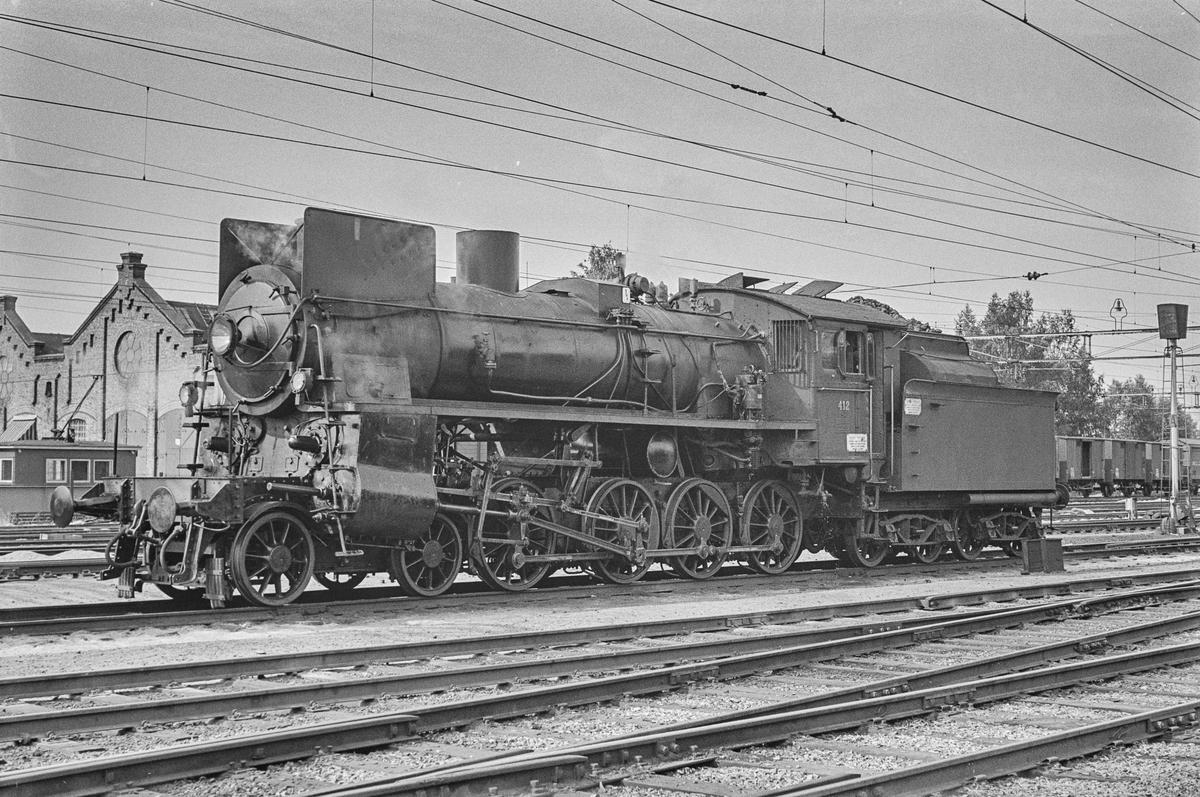Damplokomotiv type 26c nr. 412 på Hamar stasjon. .