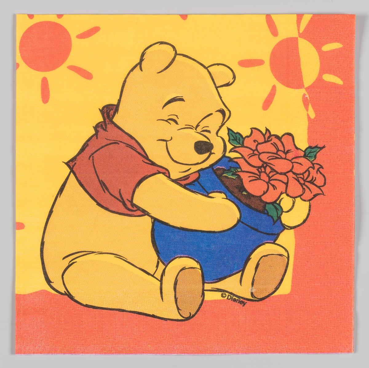 Ole Brum holder en krukke med blomster
