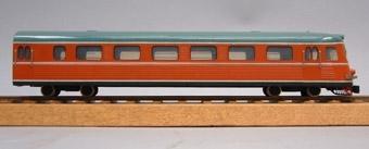 Modell i skala 1:50 av motorvagn Y0a2B, X9B, manöverenhet. Orange med grågrönt tak.  Kallades i folkmun Paprikatåget.
