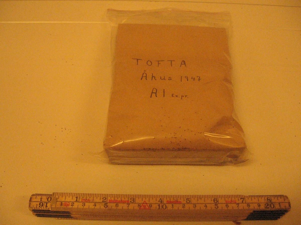 Brun papperspåse med tobaksfrön från Tofta, Åhus.