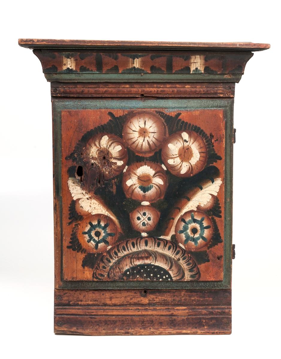 Hängskåp, litet, dekor i dalstil.  Märkt 1784.