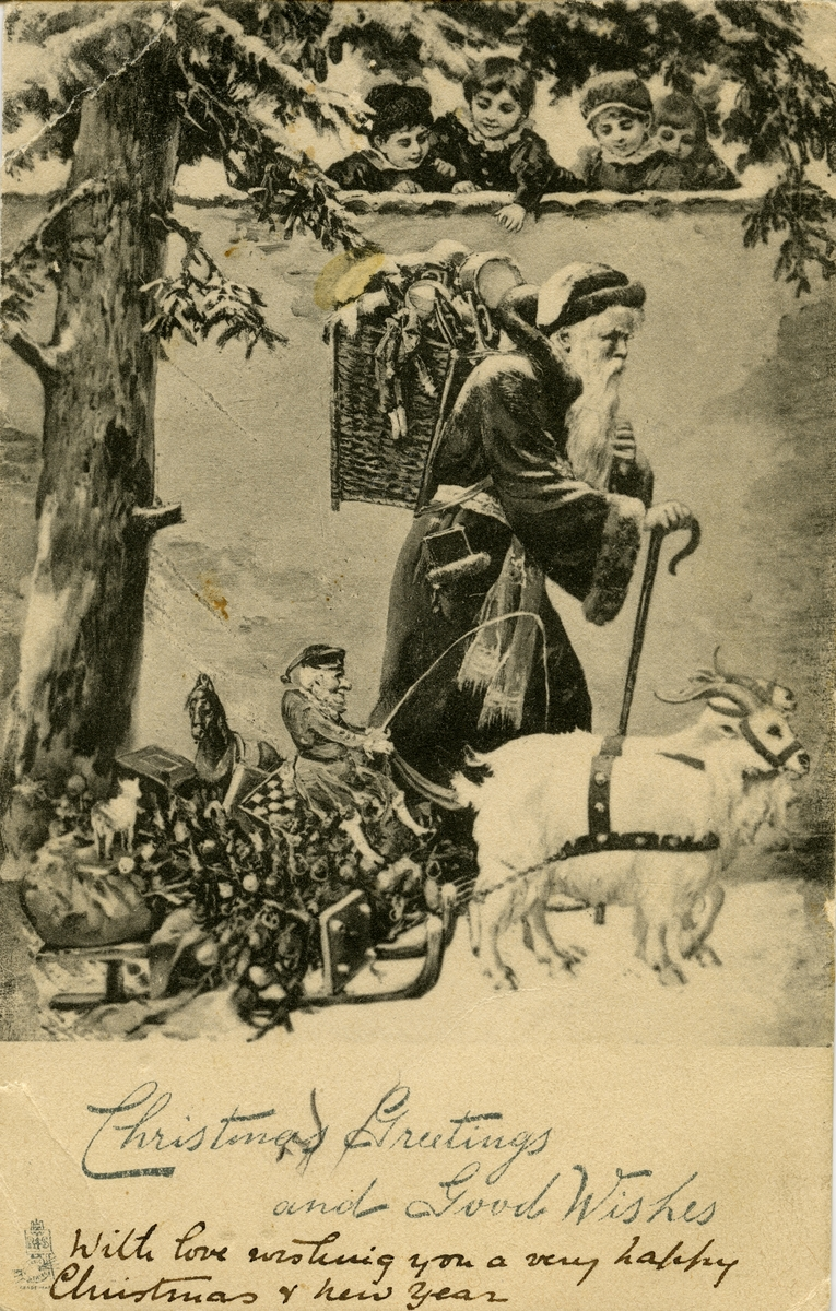 Julekort. Jule- og nyttårshilsen. Barn henger over en mur når julenissen går forbi, en liten mann sitter på en slede med mange julegaver som blir trukket av to geiter. Engels tekst.