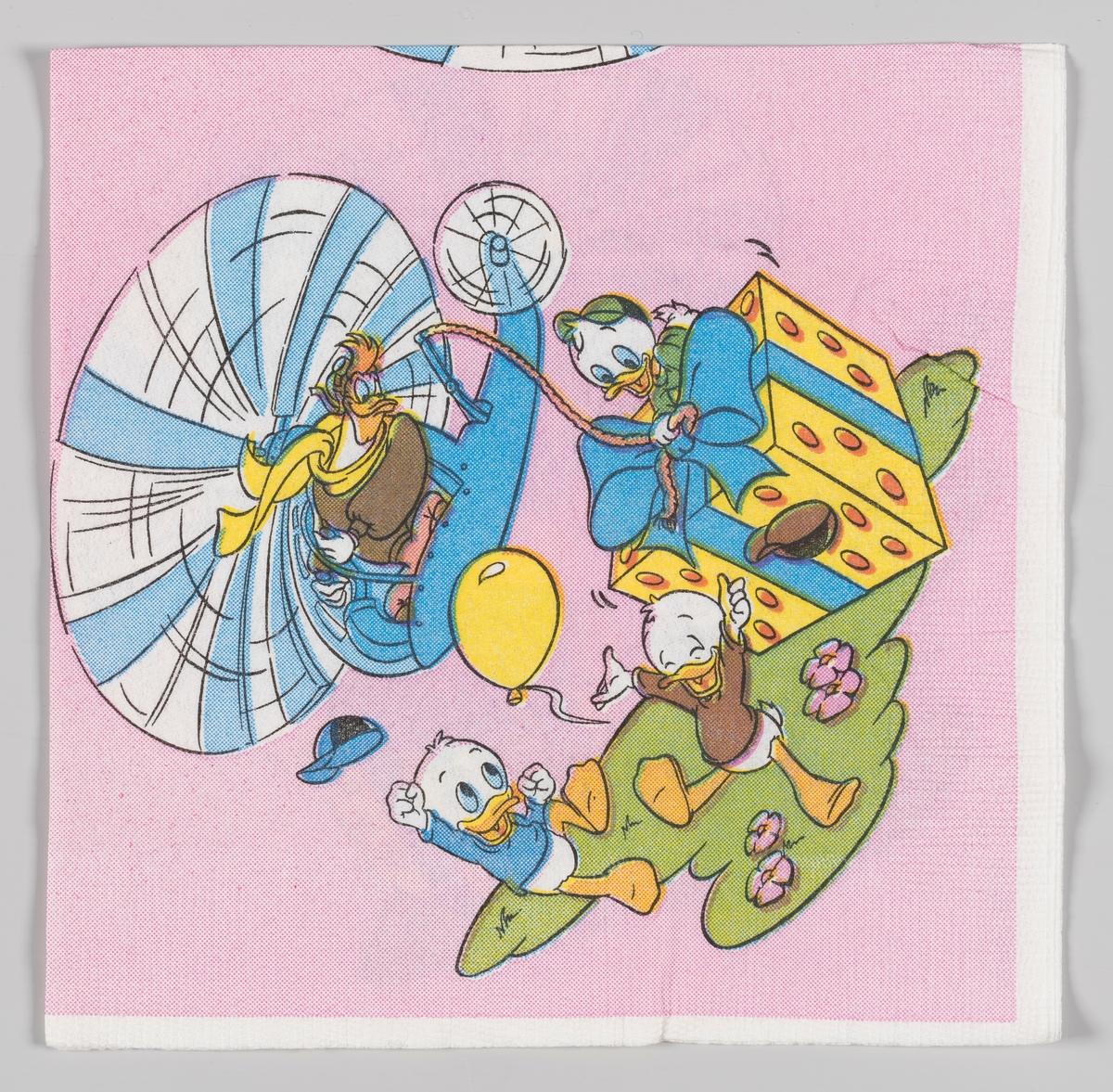 Ole, Dole og Doffen binder en stor presang fast i et tau som er festet i en helikopter