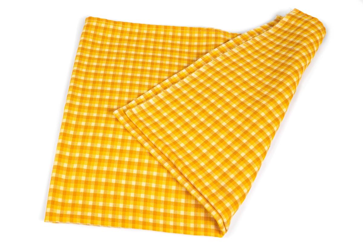 Bordsduk som följde med Vegakryssarne Tertias utrustning. Smårutig i gult och orange.