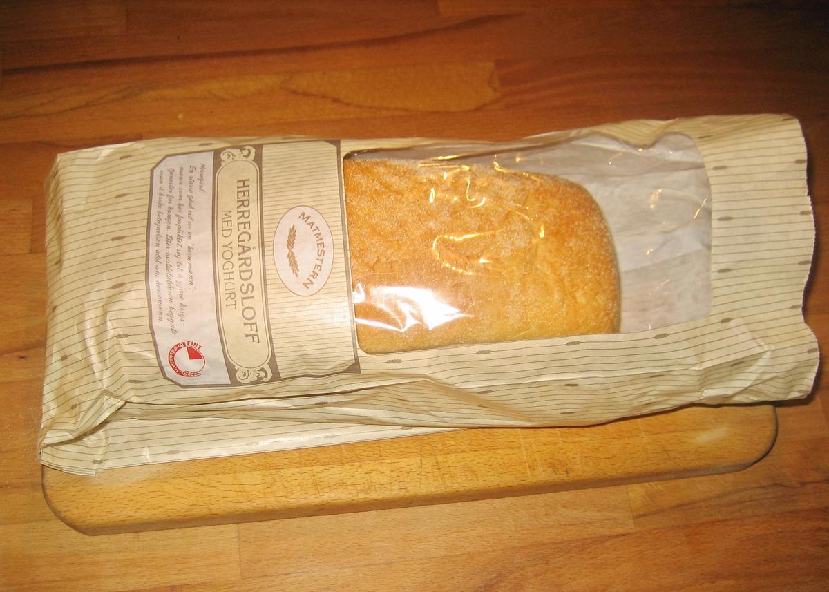 Brødposen har et stribet mønster med kornaks.