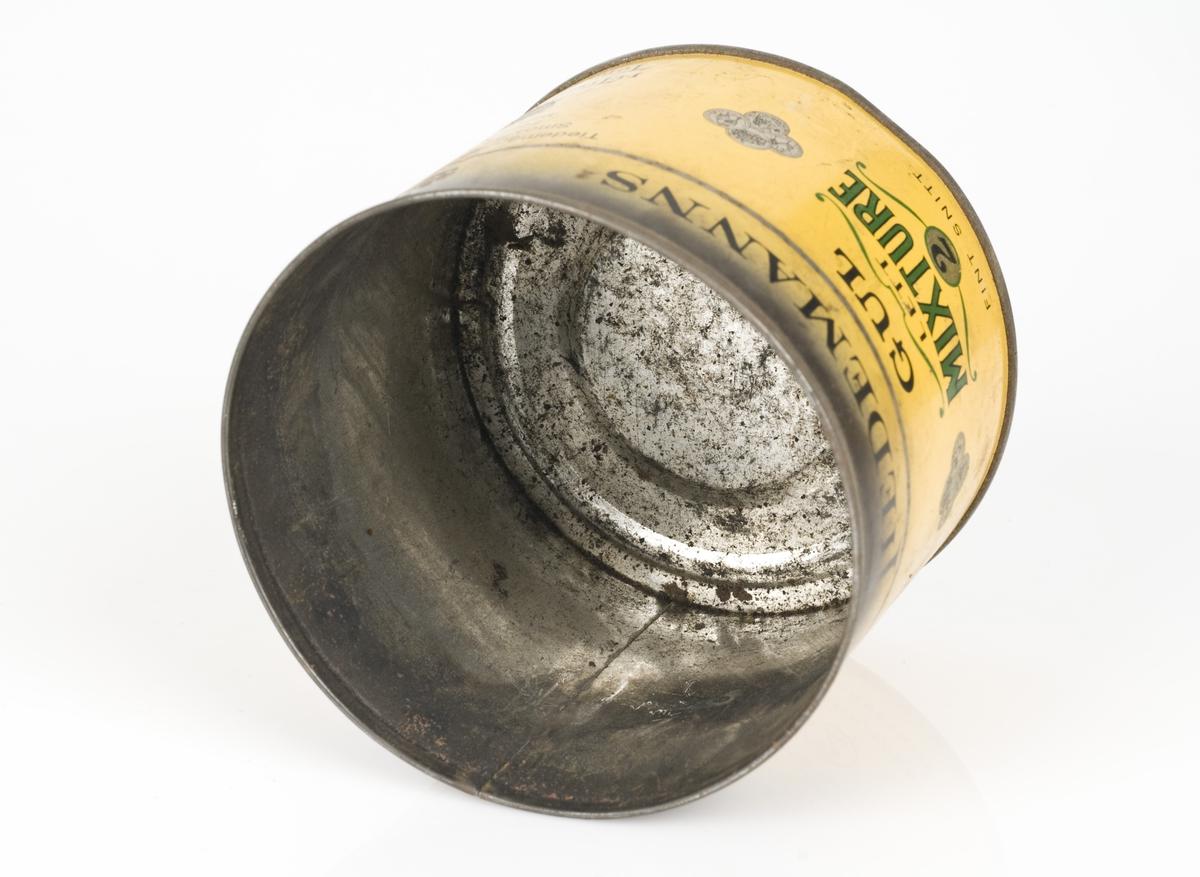 Rund tobakksboks uten lokk. Boksen er tom.